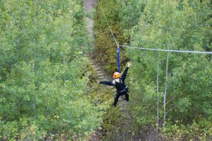 A happy camper riding the Shekinah zipline