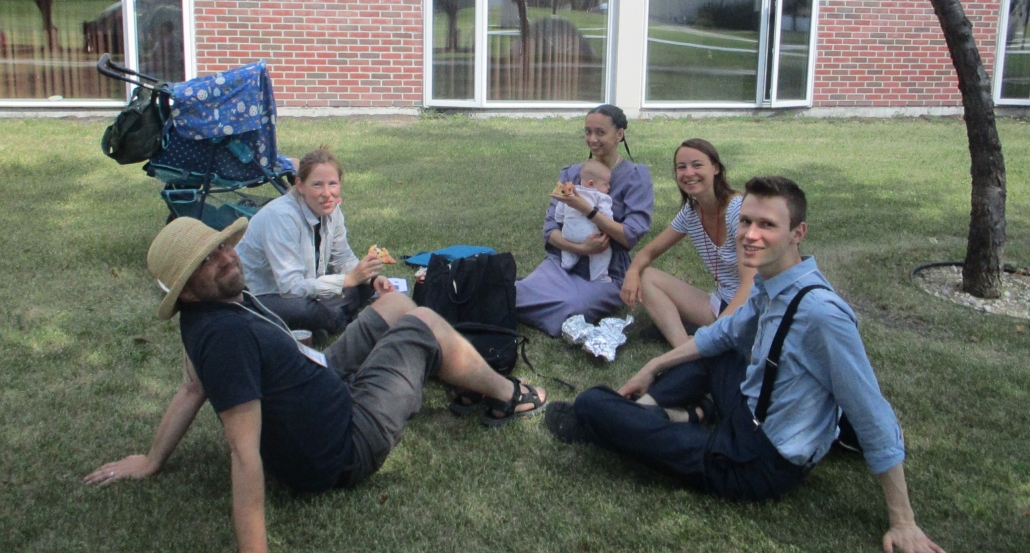 Youngish Friends hanging out on the lawn