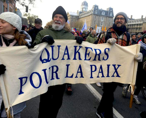 "Quakers marching with peace banner - ""Quakers pour la paix"""